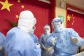 Medical staff in discussion at a makeshift hospital to treat coronavirus patients in Wuhan on Friday. Photo: EPA-EFE