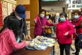 Elderly Hong Kong residents queue up for surgical masks on Sunday. Photo: Alvin Lum