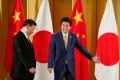 Chinese President Xi Jinping (left), pictured during talks with Japanese Prime Minister Shinzo Abe in Osaka last June, is still expected to visit Japan in April. Photo: AFP