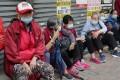 Elderly citizens queue for free surgical masks in Hong Kong's Sham Shui Po neighbourhood. Photo: Edmond So