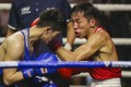 Hong Kong boxer Rex Tso (right) has a difficult task in Amman, Jordan in the Asia/Oceania Olympic qualifiers. Photo: Winson Wong
