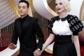 Rami Malek rocks a vintage Pasha de Cartier watch, with Lucy Boynton, on the red carpet during the Oscars arrivals at the 92nd Academy Awards in Hollywood. Photo: Mike Blake