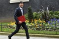 Britain's new Chancellor of the Exchequer Rishi Sunak leaves Downing Street after a cabinet meeting in London on February 14. His family connections to the Indian IT industry could have positive spin-offs in trade relations between Britain and India. Photo: EPA-EFE
