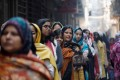 Women wait to cast their vote outside a polling booth during the state assembly election, in Shaheen Bagh, New Delhi, on February 8. Photo: Reuters