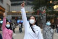 Domestic helpers socialise on their day off in Central while wearing masks to ward off infection by the coronavirus on February 2. Photo: Nora Tam