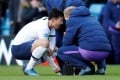 Tottenham Hotspur's Son Heung-min gets treatment on his injured arm in the English Premier League game against Aston Villa. Photo: Reuters