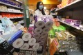 A shopper stocks up on toilet rolls at a supermarket in Hong Kong on February 5 amid fears over the coronavirus outbreak. Photo: Nora Tam