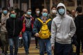 People wear face masks in Hong Kong, on February 9. Photo: AFP
