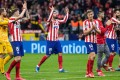 Atletico Madrid players celebrate after taking a 1-0 first leg lead over Liverpool in their Champions League last-16 tie. Photo: EPA