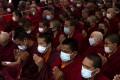 Buddhist monks wear protective masks at a mass prayer meeting for victims of the coronavirus in Kathmandu, Nepal. Photo: EPA-EFE