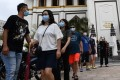 Visitors wearing face masks walk past a mosque in Singapore. Photo: AFP