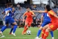 China's Zhang Linyan (in red) dribbles the ball during the Olympic football tournament qualifying group match against Taiwan at Campbelltown Stadium in Sydney. Photo: AFP