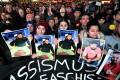 Mourners gathered at the Marktplatz in Hanau, Germany, this month. At least nine people were killed in two shootings at shisha bars in Hanau, police said. Photo: EPA-EFE