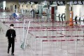 Ticket counters are deserted at the airport in Daegu, South Korea, on Monday. Photo: EPA-EFE