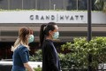 Two women in protective masks walk past a hotel in Singapore on February 7, 2020. Photo: EPA