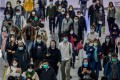Commuters in protective masks walk through an MTR station in Hong Kong. Photo: Bloomberg