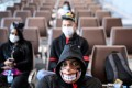 People wear masks at the Kai Tak cruise terminal on February 5. In Hong Kong and elsewhere, the lessons of Sars are helping to combat the spread of the Covid-19 coronavirus. Photo: AFP