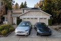 Tesla's Model X and Model 3 cars parked in the driveway of a home with a Tesla Solar Roof in San Ramon, California, on Saturday, February 8, 2020. Photo: Bloomberg