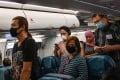 Aeroplane passengers arrive at Suvarnabhumi Airport in Bangkok. Photo: AFP