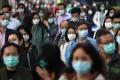 Pedestrians wearing masks in Kowloon Bay. 27FEB20 SCMP / Xiaomei Chen