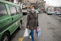 An Iranian woman wears a face mask as she walks in northern Tehran on Wednesday. Photo: dpa
