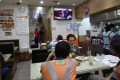 A television plays Financial Secretary Paul Chan delivering the 2020/21 budget at a restaurant in Sham Shui Po. Photo: Xiaomei Chen