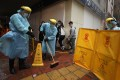 Workers disinfect the pavement outside a location in North Point after another person linked to the Fook Wai Ching She worship hall was confirmed positive for the coronavirus. Photo: Xiaomei Chen