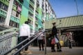 Residents walk through the courtyard of a public housing estate in Hong Kong on February 23. Photo: AFP