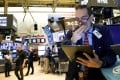 Traders work on the floor at the New York Stock Exchange on Thursday. Photo: Reuters