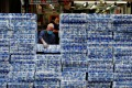 An employee restocks rolls of toilet paper at a market in Hong Kong, where fears over the supply chain from China has sparked panic buying. Photo: Reuters