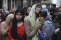 Relatives and neighbours grieve over the loss of loved ones in New Delhi on February 27, 2020. Photo: AP
