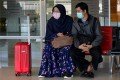 An Indonesian woman and man are pictured at an airport in Aceh Besar. Photo: AFP