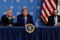US President Donald Trump is flanked by Anthony Fauci (left), director of the NIH National Institute of Allergy and Infectious Diseases, and Health and Human Services Secretary Alex Azar during a briefing in Bethesda, Maryland, on Monday. Photo: Reuters