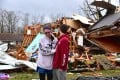 Deanna and Tony Speck, of Cookeville, Tennessee console one another on the front lawn of what's left of Deanna's parent's house. Photo: AP