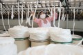 Firms involved in labour-intensive industries like textiles could be the first to flee China, a report says. Photo: Reuters