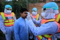 Pakistani health workers check the body temperature of a person during a drill conducted to improve efforts to contain the spread of coronavirus, as cases in neighbouring Iran soar. Photo: EPA-EFE