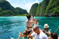 Tourists take pictures of Koh Phi Phi Leh, in Thailand. Photo: AFP
