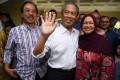 Malaysian Prime Minister Muhyiddin Yassin, alongside his wife Noraini Abdul Rahman. Photo: AFP