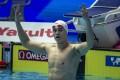 Sun Yang celebrates after winning the men's 400m freestyle gold at the 2019 world championships. Photo: EPA