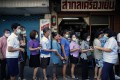 People queue to buy face masks outside a pharmacy in Bangkok, Thailand, on March 4, 2020. Photo: EPA-EFE