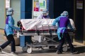 Medical workers transfer a patient in Daegu, South Korea. Photo: Xinhua