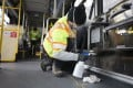 A worker cleans a bus in Seattle, Washington, on Tuesday. Photo: AFP
