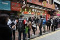 Queues for surgical masks in Causeway Bay, Hong Kong, in February. Photo: SCMP