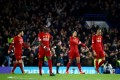 Liverpool players look dejected after Chelsea knocked them out of the FA Cup earlier this week. Photo: Reuters