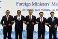 Chinese Foreign Minister Wang Yi (centre) with Asean foreign ministers in Vientiane, Laos on February 20. Wang attended an emergency meeting with his Asean counterparts to discuss cooperation in containing the Covid-19 outbreak crisis. Photo: EPA-EFE