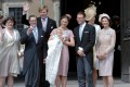 Sweden's Crown Princess Victoria (centre) holds Princess Estelle after her christening ceremony in Stockholm in May 2012, attended by (from left) Ewa and Olle Westling, parents of Sweden's Prince Daniel, Crown Prince Willem Alexander of the Netherlands, Denmark's Crown Prince Daniel, and other royals. Photo: Reuters