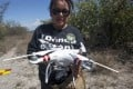 Leticia Hidalgo prepares a drone to search for her son. Photo: AFP