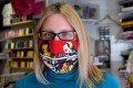 A woman wears a colourful face mask created by Croatian fashion designer Zoran Aragovic. His cotton masks in distinctive pop-art style are designed to counter fears of coronavirus, not the virus itself, he says. Photo: AFP