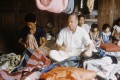 American businessman Jim Thompson pictured with some of Baan Krua's silk weavers in 1955. Photo: Getty Images
