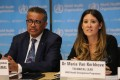 Maria Van Kerkhove, acting head of the World Health Organisation's emerging diseases unit, speaks about the coronavirus outbreak with WHO director general Tedros Adhanom Ghebreyesus. Photo: Xinhua